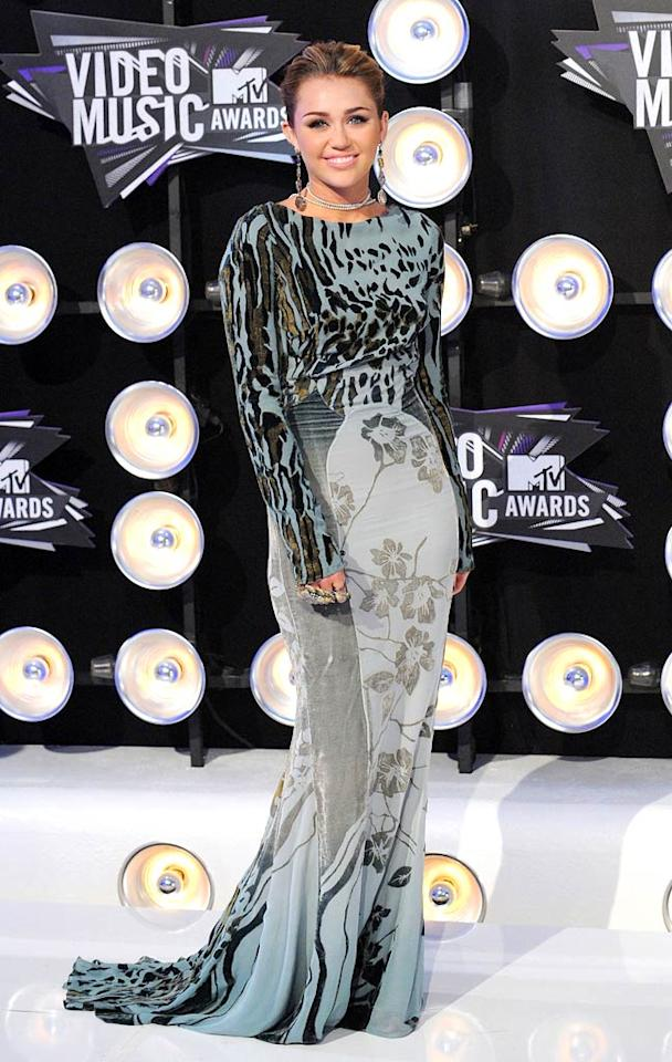 """In August, Miley did come out of hiding to serve as a presenter at the 2011 MTV Video Music Awards in a """"wild"""" Roberto Cavalli dress. We've missed her on the red carpet this year! (08/28/2011)"""