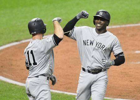 Oct 11, 2017; Cleveland, OH, USA; New York Yankees shortstop Didi Gregorius (18) celebrates with left fielder Brett Gardner (11) after hitting his second home run during the third inning of game five of the 2017 ALDS playoff baseball series against the Cleveland Indians at Progressive Field. David Richard-USA TODAY Sports