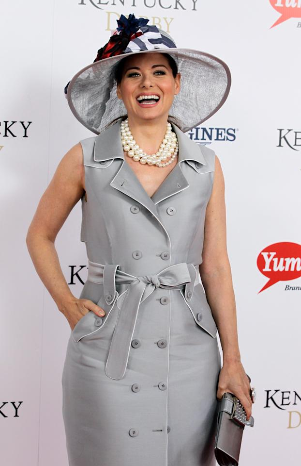 "<p class=""MsoNormal"">Though the official drink of the Kentucky Derby is the mint julep (made of mint, bourbon, and sugar), newly single ""Smash"" star Debra Messing had the honor of wearing the Grey Goose Cherry Noir-inspired hat for the annual event on Saturday. For the past eight years, the vodka brand has joined forces with a milliner who designs a topper for the Derby commemorating the launch of Grey Goose's latest flavor.</p>"