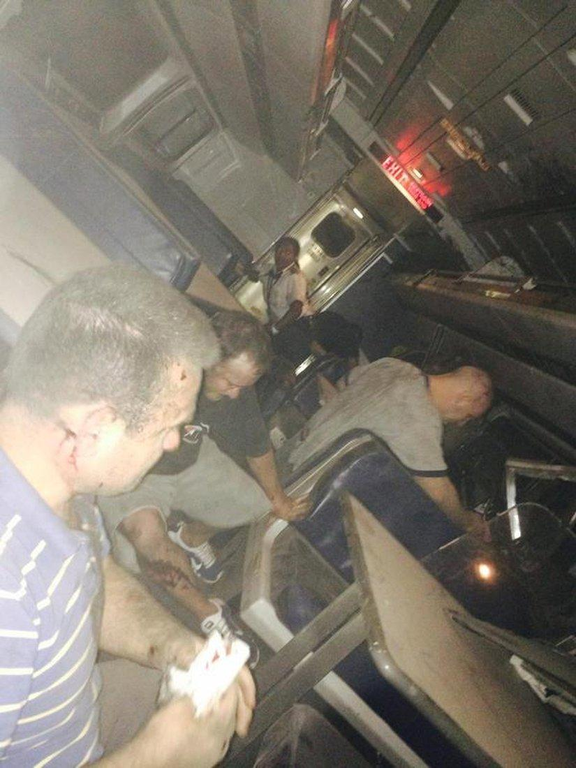 Passengers are seen inside the derailed Amtrak train in Philadelphia May 12, 2015 in a photo provided by former Pennsylvania Congressman Patrick Murphy, who was a passenger on the train. An Amtrak passenger train with more than 200 passengers on board derailed in north Philadelphia on Tuesday night, killing at least five people and injuring scores of others, several of them critically, authorities said. Picture taken May 12, 2015. REUTERS/@PatrickMurphyPA/Handout via Reuters ATTENTION EDITORS - THIS PICTURE WAS PROVIDED BY A THIRD PARTY. REUTERS IS UNABLE TO INDEPENDENTLY VERIFY THE AUTHENTICITY, CONTENT, LOCATION OR DATE OF THIS IMAGE. THIS PICTURE IS DISTRIBUTED EXACTLY AS RECEIVED BY REUTERS, AS A SERVICE TO CLIENTS. FOR EDITORIAL USE ONLY. NOT FOR SALE FOR MARKETING OR ADVERTISING CAMPAIGNS. NO SALES. NO ARCHIVES. NO COMMERCIAL USE.