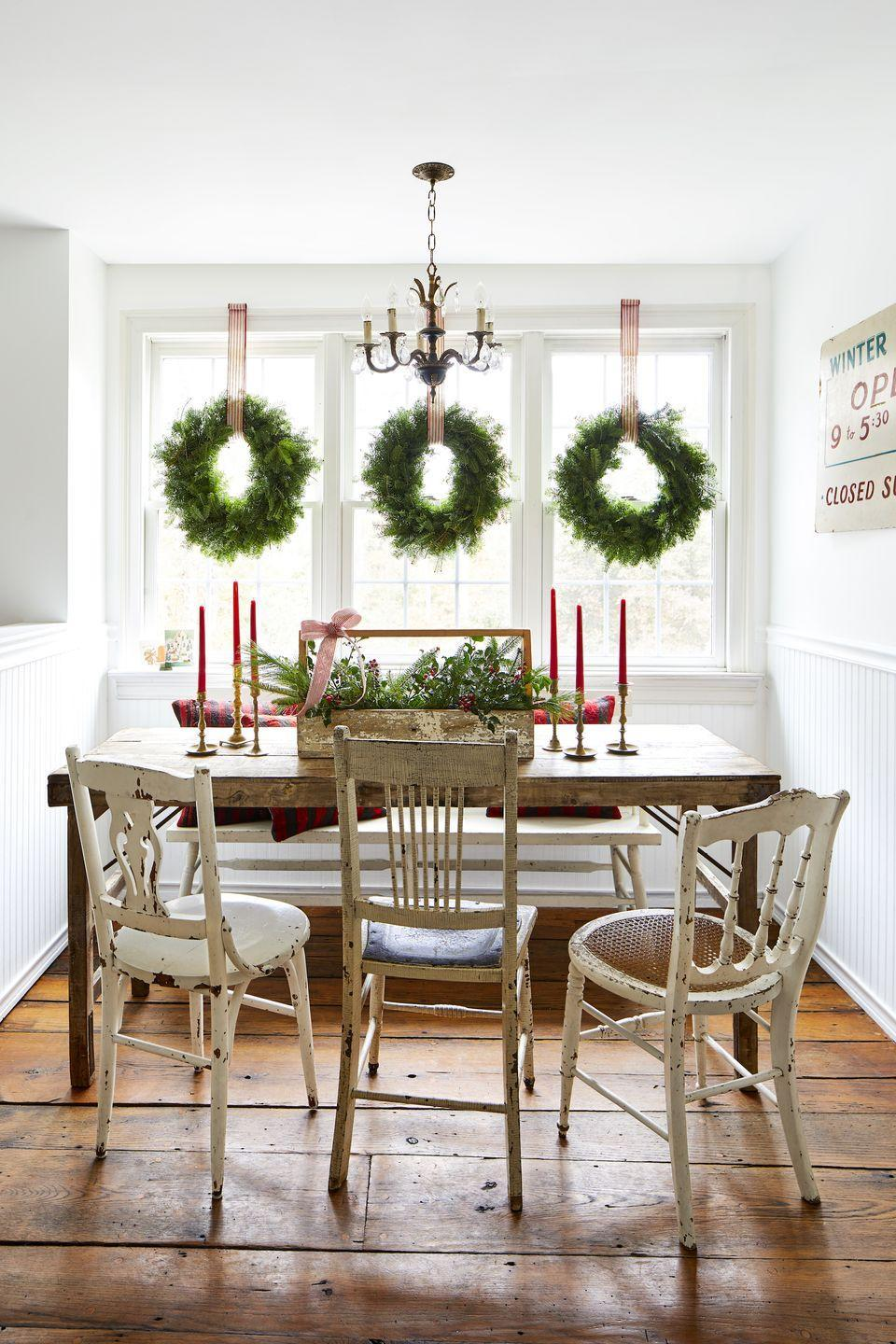 """<p>This classic look never goes out of style. Simply hang wreaths with wide, red-and-white ticking striped ribbon. Conceal a small nail or hook out of sight on the top of your window frame. <br></p><p><a class=""""link rapid-noclick-resp"""" href=""""https://www.amazon.com/Yards-White-Tri-Striped-Wired-Ribbon/dp/B07BW6QL75/ref=sr_1_4?dchild=1&keywords=red+and+white+ticking+stripe+ribbon&qid=1604018543&sr=8-4&tag=syn-yahoo-20&ascsubtag=%5Bartid%7C10050.g.23343056%5Bsrc%7Cyahoo-us"""" rel=""""nofollow noopener"""" target=""""_blank"""" data-ylk=""""slk:SHOP RIBBON"""">SHOP RIBBON</a></p>"""