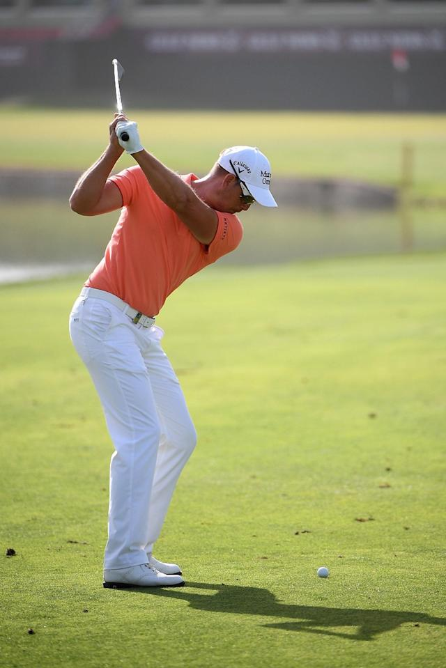 "<h1 class=""title"">Omega Dubai Desert Classic - Previews</h1> <div class=""caption""> DUBAI, UNITED ARAB EMIRATES - JANUARY 24: Henrik Stenson of Sweden, swing sequence with a iron (frame 5 of 12) during the pro-am event prior to the Omega Dubai Desert Classic at Emirates Golf Club on January 24, 2018 in Dubai, United Arab Emirates. (Photo by Ross Kinnaird/Getty Images) </div> <cite class=""credit"">Ross Kinnaird</cite>"