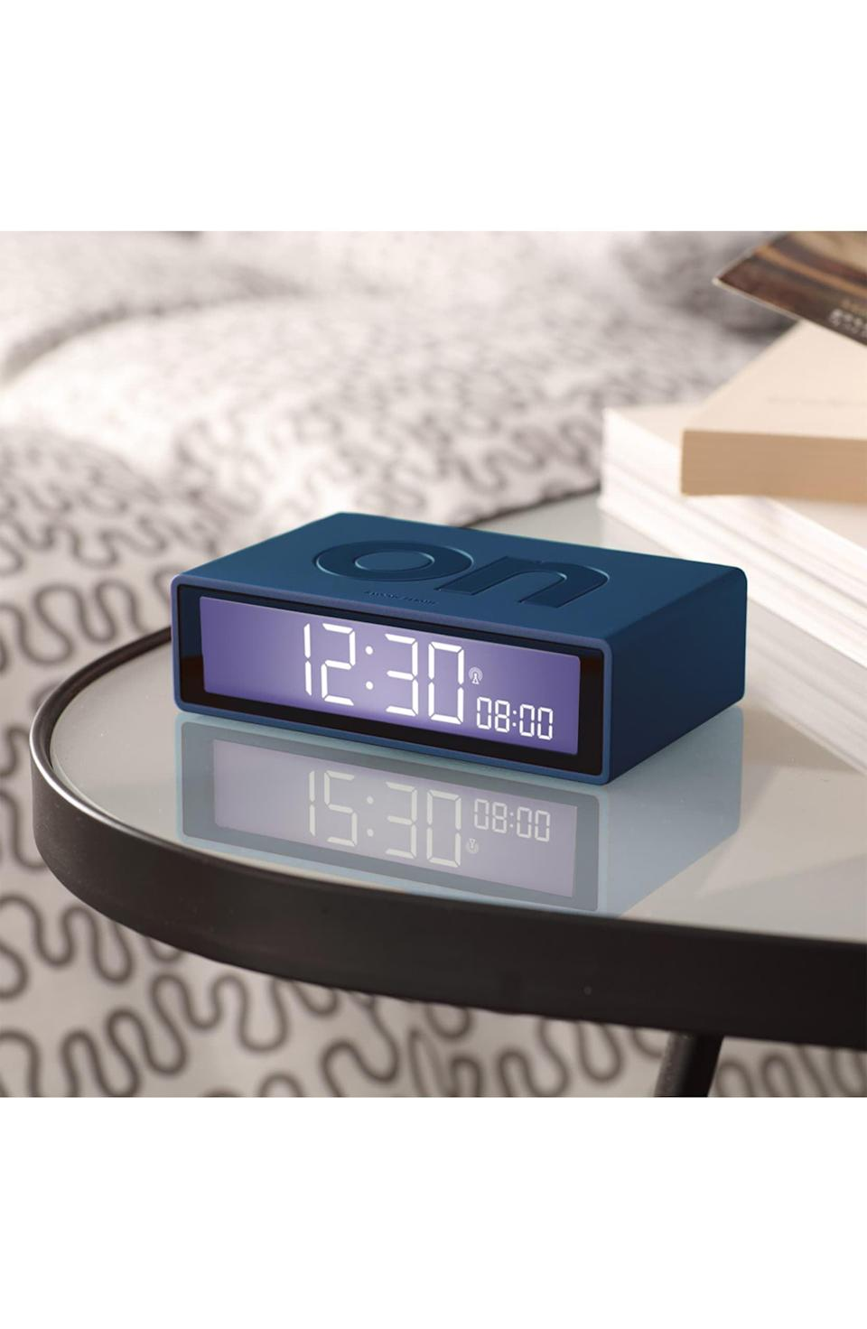 <p>Get this <span>Lexon Flip+ Alarm Clock</span> ($40) for the person who never wakes up on time.</p>