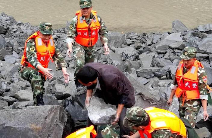 A report from the state news agency Xinhua said that the landslide occurred when the high part of a mountain in the Tibetan and Qiang Autonomous Prefecture of Aba collapsed (AFP Photo/STR)
