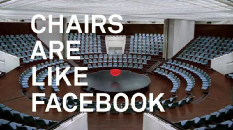 This undated image pulled from video shows a video Facebook released Thursday, Oct. 4, 2012, that, somewhat abstractly, seeks to illustrate its ubiquity and utility in connecting people to one another. Directed by Alejandro Gonzalez Inarritu, the video starts off with an empty red chair suspended in midair in a forest. Then it moves to chairs with people, first just one then two, and groups around a dinner table, dancing, playing. Then more chairs. It's Facebook's first advertising campaign surrounding its brand. So far, though, the company is not saying whether the video will air on television. (AP Photo/Facebook)