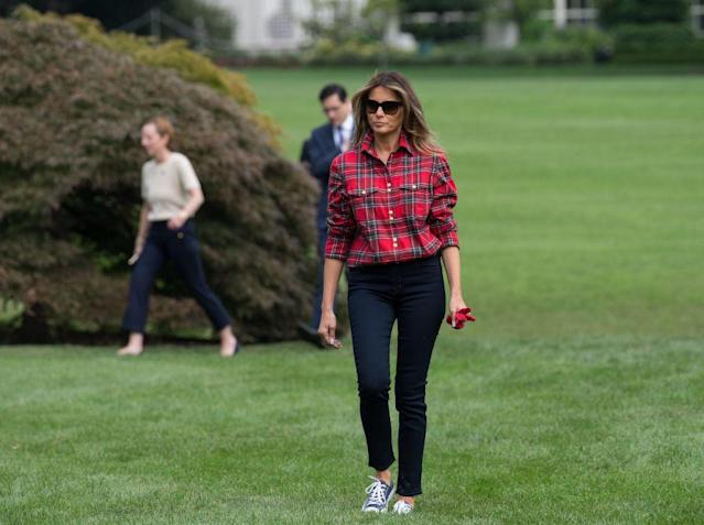 <p>FLOTUS wore a fall-inspired outfit to host her first White House Kitchen Garden event. She opted for a simple plaid shirt, dark blue skinny jeans, and Converse sneakers. </p>