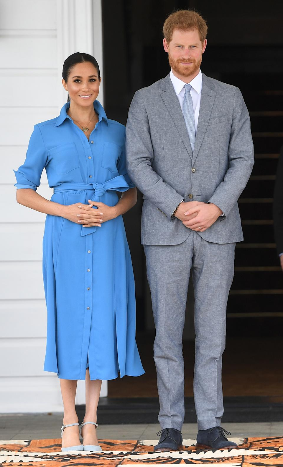 <p>The Duchess of Sussex wore a brilliant blue shirt dress to meet the King and Queen of Tonga in September 2019 during a 16 day royal tour abroad. <em>(Image via Getty Images)</em></p>