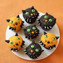 """<p>This treat isn't scary at all! Once you bake your cupcakes, just frost them and dip them in black and orange sanding sugars. Add the little faces with candy.</p><p><a href=""""https://www.womansday.com/food-recipes/food-drinks/recipes/a11375/kitten-cupcakes-recipe-wdy1012/"""" rel=""""nofollow noopener"""" target=""""_blank"""" data-ylk=""""slk:Get the Kitten Cupcakes recipe."""" class=""""link rapid-noclick-resp"""">Get the Kitten Cupcakes recipe. </a></p>"""
