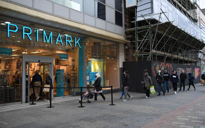 Shoppers queueing at Primark in Glasgow - Andy Buchanan/AFP