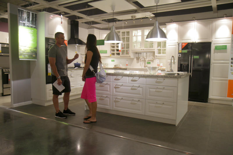 A couple looking at a kitchen retail display in IKEA. (Photo by: Jeffrey Greenberg/Universal Images Group via Getty Images)