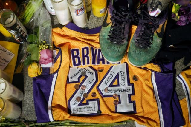 Memorabilia and candles sit in Microsoft Square near the Staples Center to pay respects to Kobe Bryant after a helicopter crash killed the retired basketball star