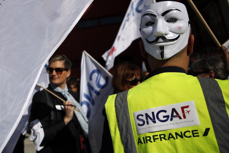 Air France workers gather next to the company headquarters during a demonstration in Tremblay-en-France, outside Paris, Wednesday, April 11, 2018. About 30 percent of Air France flights scheduled on Wednesday are expected to be canceled as flight crews and ground staff started a seventh day of strike. (AP Photo/Christophe Ena)