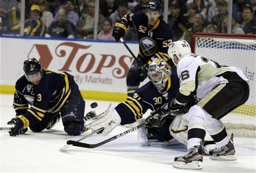 Pittsburgh Penguins' Steve Sullivan (26) scores on Buffalo Sabres goalie Ryan Miller during the second period of an NHL hockey game in Buffalo, N.Y., Friday, March 30, 2012. (AP Photo/David Duprey)