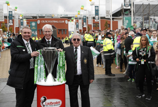 "Britain Football Soccer - Celtic v Heart of Midlothian - Scottish Premiership - Celtic Park - 21/5/17 Tommy Boyd, Jim Craig (C) and Willie Wallace (R) with the Scottish Premiership Trophy outside the stadium before the match Reuters / Russell Cheyne Livepic EDITORIAL USE ONLY. No use with unauthorized audio, video, data, fixture lists, club/league logos or ""live"" services. Online in-match use limited to 45 images, no video emulation. No use in betting, games or single club/league/player publications. Please contact your account representative for further details."