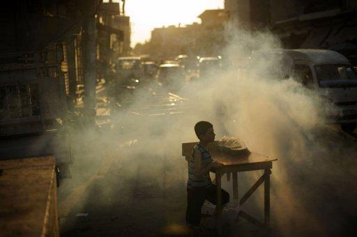 A Syrian boy waits for customers at a roadside stall set up just in time for the iftar meal with which Muslims break their fast during the fasting month of Ramadan in the town of Azaz, north of Aleppo, on August 11. The battle for Syria is raging on the ground but also on social media, where people on both sides of the conflict are hacking, posting and spamming in a frenzied propaganda war