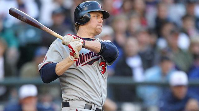 "<p>After a 14-year career that saw him crowned as the American League's top player in 2006, Justin Morneau is hanging up his spikes. The veteran first baseman is reportedly joining the Twins, the team with which he spent the bulk of his time in the majors, <a href=""https://www.mlb.com/twins/news/twins-hire-justin-morneau-as-special-assistant/c-264448924"" rel=""nofollow noopener"" target=""_blank"" data-ylk=""slk:as a special assistant to their front office"" class=""link rapid-noclick-resp"">as a special assistant to their front office</a>, bringing an end to his playing days at the age of 36.</p><p>Born in Canada and drafted out of a British Columbia high school by Minnesota in the third round of the 1999 draft, Morneau made his debut in 2003 but didn't become a regular at first base until the second half of the '04 season, after the Twins traded veteran starter Doug Mientkiewicz to the Red Sox. The lefty-swinging Morneau quickly became a feared presence alongside catcher Joe Mauer in the middle of Minnesota's order: From 2005 through an injury-shortened '10, he averaged 26 home runs and 101 RBIs per season, hitting .289/.362/.513 with a 131 OPS+. That included his MVP-winning 2006 season, when he bashed 34 home runs, drove in 130 runs, hit .321/.375/.559, and narrowly edged out Derek Jeter for the hardware (though Morneau led the AL in none of those categories, and his 4.3 Wins Above Replacement that year was good for just 23rd among all Junior Circuit regulars), as well as a runner-up finish to Dustin Pedroia in '08. Those numbers also helped earn Morneau a six-year, $80 million deal after the '07 season.</p><p>With Morneau, Mauer and ace Johan Santana all flourishing at once, the Twins won five AL Central crowns from 2003 through '10, but they were knocked out of the playoffs in the Division Round every time—four times by the Yankees, three times in sweeps. The division title in '10 was the end of the road for those Twins, who plummeted to 99 losses and the Central basement the next year, beginning a run of four straight sub-.500 seasons in the Twin Cities. That coincided with Morneau's decline: Injuries, including a concussion he suffered sliding into a base in July 2010 and which plagued him for years afterward, limited to him an average of 95 games per season from '10 through '12. His inability to stay on the field and fading numbers brought an end to his time with the Twins in August 2013, when they dealt him to the Pirates for a pair of minor leaguers.</p><p>Morneau's stay in Pittsburgh was brief and unexceptional, and after hitting free agency that winter, he signed a modest two-year pact worth $14 million with the Rockies. That looked to be a shrewd move by Colorado, as Morneau won the NL batting title in 2014 with a .319 average, hit 17 home runs, and posted his highest full-season OPS+ (125) and WAR (3.2) totals since '09. But his '15 season was mostly washed out by another concussion suffered on a diving play, as he appeared in only 49 games, and Colorado declined its end of a mutual option at the end of the year. A free agent once again, Morneau returned to the AL Central by signing a one-year, $1 million contract with the White Sox, but an elbow injury cost him the first half of the season, and his bat never recovered, as he hit a mere .261/.303/.429 in 218 plate appearances at the age of 35.</p><p>Morneau was active at the beginning of 2017, playing for Team Canada in the World Baseball Classic, but he was unable to parlay his brief time in the tournament into another major league job, and it looks like he's decided that this will be the end of the line for him. He finishes his career with 247 home runs and a lifetime .281/.348/.481 batting line to go with his MVP trophy, four All-Star team nods, and two Silver Slugger awards. And while that's not a Hall of Fame career by any stretch, he'll still walk away as one of the top hitters of the 2000s, one of the best Canadian players ever, and as a standout figure in Twins franchise history. Good luck and happy trails, Justin.</p>"