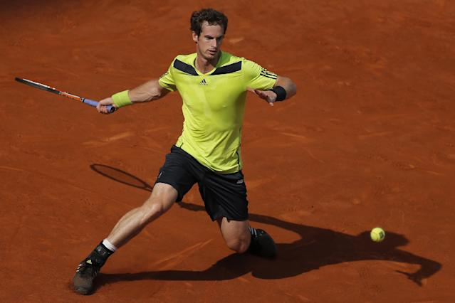Andy Murray from Britain returns the ball during a Madrid Open tennis tournament match against Santiago Giraldo from Colombia in Madrid, Spain, Thursday, May 8, 2014. (AP Photo/Andres Kudacki)