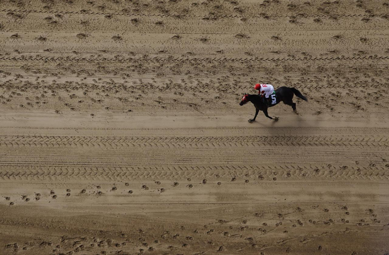 Jockey Oriana Rossi rides Little Willy back to the paddock after placing second in the first race before the 138th Kentucky Derby horse race at Churchill Downs Saturday, May 5, 2012, in Louisville, Ky. (AP Photo/Charlie Riedel)