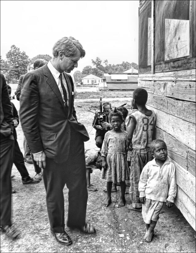 <p>Kennedy in Cleveland, Miss., visits children from the Dillard family on April 11, 1967. (Photo: Dan Guravich) </p>