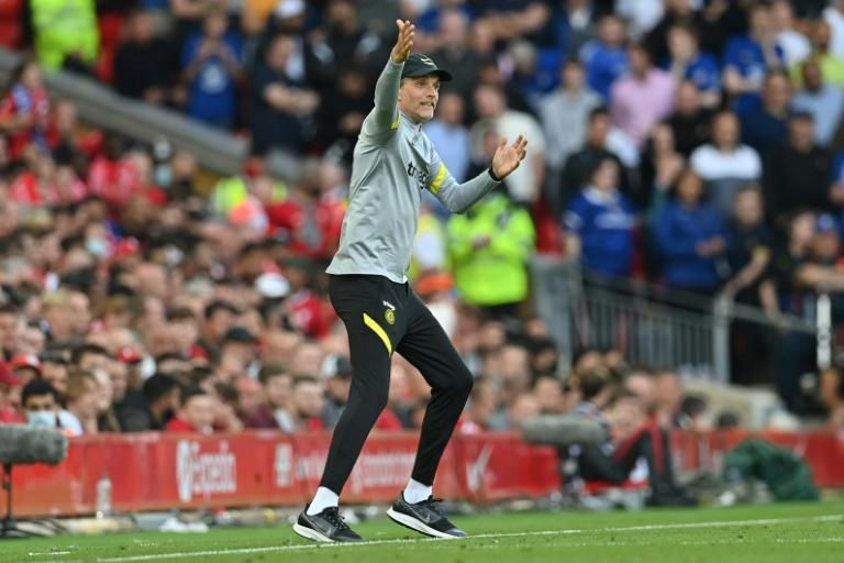 'World upside down': Chelsea's head coach Thomas Tuchel gestures on the touchline at Anfield (AFP/Paul ELLIS)