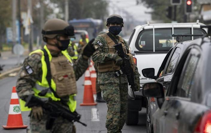 Soldiers were deployed to parts of Santiago one day after rioting erupted over the COVID-19 restrictions and the lack of government aid for the unemployed (AFP Photo/MARTIN BERNETTI)