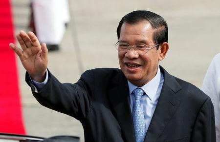 FILE PHOTO - Cambodia's Prime Minister Hun Sen waves to well wishers upon his arrival to attend the Association of South East Asian Nations (ASEAN) Summit and related meetings in Clark, Pampanga