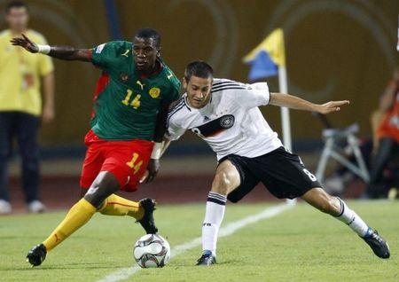 Vrancic of Germany challenges Ekeng of Cameroon during their FIFA U-20 World Cup soccer match in Ismailia
