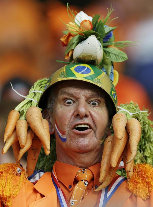 In this Friday, June 13, 2014 photo, a Dutch fan wears a homemade hat during the group B World Cup soccer match between Spain and the Netherlands at the Arena Ponte Nova in Salvador, Brazil. A dominating second half had the orange-clad Dutch fans in Arena Fonte Nova on their feet as they watched their team thrash the world champions 5-1. It was the worst loss for Spain in the game's showcase tournament since a 6-1 defeat to Brazil in 1950. (AP Photo/Natacha Pisarenko)