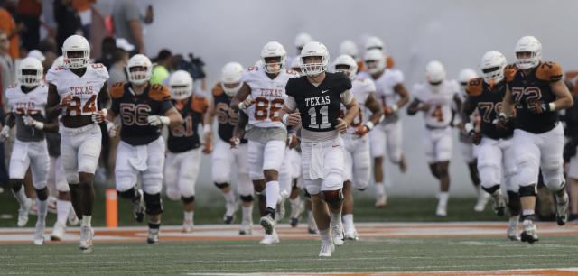 "Texas quarterback <a class=""link rapid-noclick-resp"" href=""/ncaaf/players/275098/"" data-ylk=""slk:Sam Ehlinger"">Sam Ehlinger</a> (11) leads the team on to the field during the team's Orange-White intrasquad spring college football game, Saturday, April 21, 2018, in Austin, Texas. (AP Photo/Eric Gay)"
