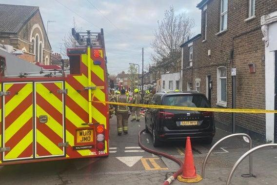 <p>Three men were rescued from the building by fire crews</p> (London Fire Brigade)