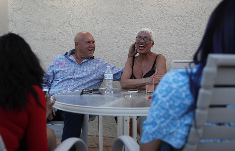 <p> FILE - In this April 27, 2018, file photo, owner Dennis Hof, left, jokes with madam Sonja Bandolik at the Love Ranch brothel in Crystal, Nev. County officials in Nevada have yanked a brothel license from the state's most famous pimp who has fashioned himself as a Donald Trump-style candidate for Nevada's legislature. Officials in Southern Nevada's Nye County on Tuesday said Dennis Hof had failed to apply for a renewal and pay fees for his Love Ranch brothel in Crystal, about an hour's drive northwest of Las Vegas. (AP Photo/John Locher, File) </p>