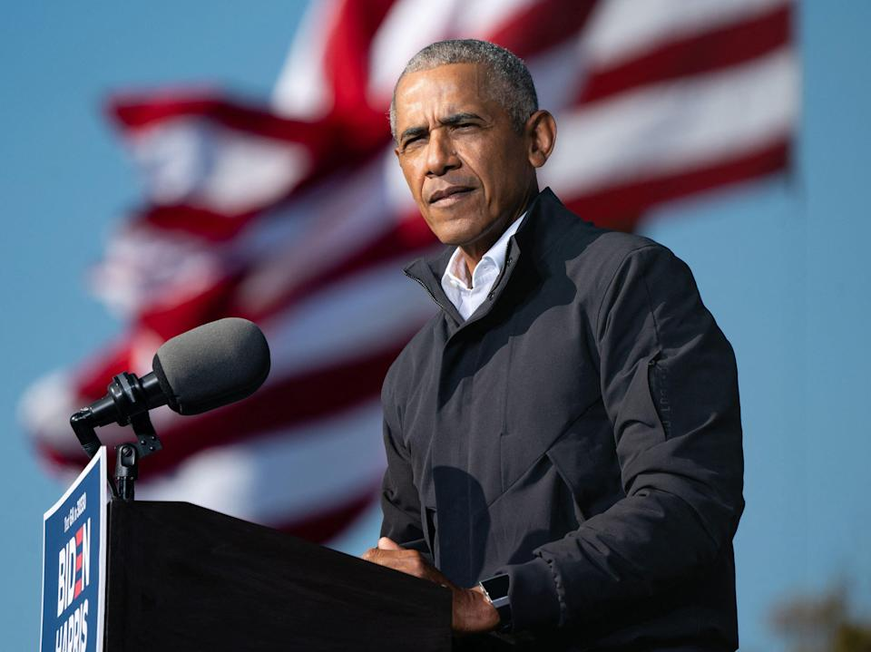Barack Obama speaks at a Get Out the Vote rally as he campaigns for Democratic presidential candidate former Vice President Joe Biden in Atlanta, Georgia on 2 November 2020 (AFP via Getty Images)