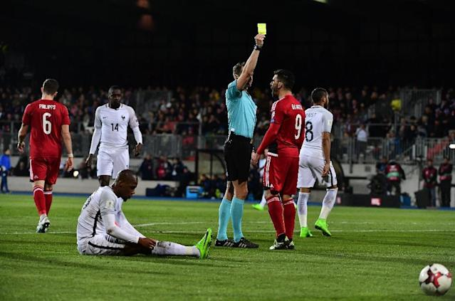 Luxembourg's Daniel Da Mota receives a yellow card during their FIFA World Cup 2018 qualifying football match against France on March 25, 2017 at Josy Bartel stadium in Luxembourg (AFP Photo/EMMANUEL DUNAND)