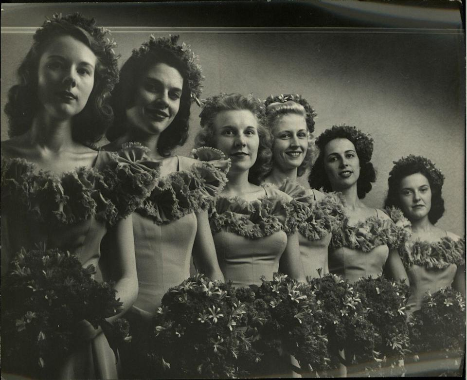 <p>Matching bridesmaids dresses remained popular during this time and off-the-shoulder, ruffled styles, like the ones pictured, were very common. </p>