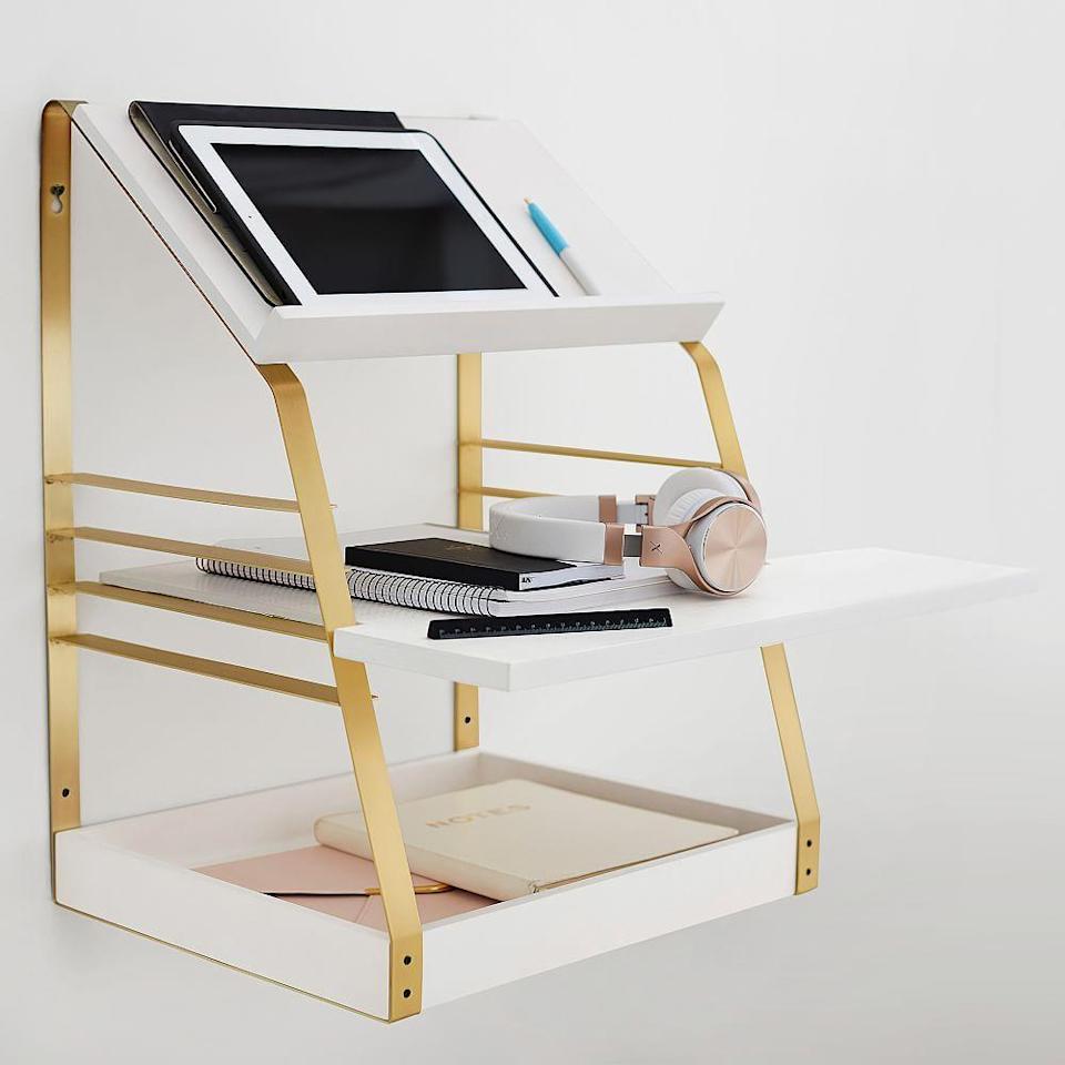 "<h3>PBteen Laddered Standing Desk</h3><br>This nifty workspace mounts to your wall for three tiers of standing office space. <br><br><strong>PBTeen</strong> Laddered Standing Desk Converter, White/Brass, $, available at <a href=""https://go.skimresources.com/?id=30283X879131&url=https%3A%2F%2Fwww.pbteen.com%2Fproducts%2Fladdered-standing-desk-converter%2F"" rel=""nofollow noopener"" target=""_blank"" data-ylk=""slk:PBTeen"" class=""link rapid-noclick-resp"">PBTeen</a>"