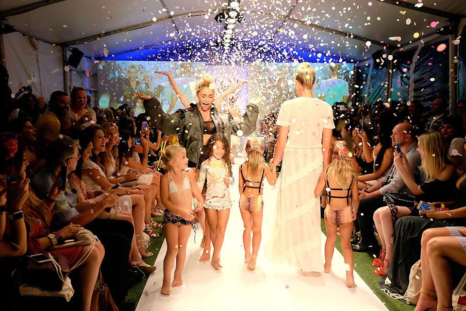 In the Hot-As-Hell fashion at SwimMiami, little girls paraded down the catwalk in skimpy suits. (Photo: Getty)