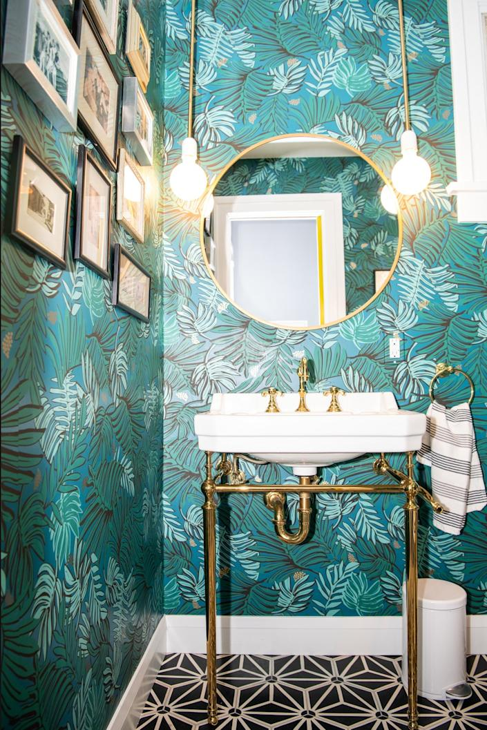 """A salon wall in the powder room. The wallpaper is by Justina Blakeney. <span class=""""copyright"""">(Mariah Tauger / Los Angeles Times)</span>"""