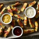 """<p>These delicious, low-carb """"fries"""" are wrapped in bacon and baked in the oven until they achieve a nice crispy coating. To keep the coating crisp, serve them on a large plate or platter (not piled in a dish) alongside BBQ sauce, ranch dressing or your favorite sauce for dipping. Thinly sliced bacon works best in this recipe for easy wrapping.</p>"""