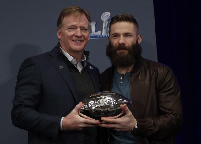 Super Bowl LIII MVP New England Patriots' Julian Edelman poses with NFL Commissioner Roger Goodell during a news conference for the NFL Super Bowl 53 football game Monday, Feb. 4, 2019, in Atlanta. The Patriots beat the Los Angeles Rams 13-3. (AP Photo/Morry Gash)