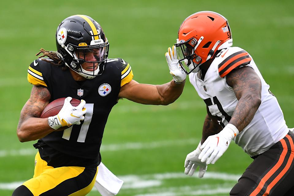 PITTSBURGH, PENNSYLVANIA - OCTOBER 18: Chase Claypool #11 of the Pittsburgh Steelers stiff arms Mack Wilson #51 of the Cleveland Browns during their NFL game at Heinz Field on October 18, 2020 in Pittsburgh, Pennsylvania. (Photo by Joe Sargent/Getty Images)