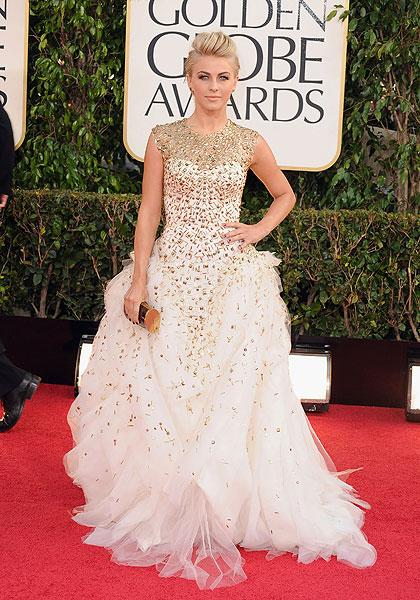 """Julianne Hough: It's not the  Oscars, Juliane! The 'Rock of Ages' star goes over-the-top in a white  tulle gown with golden jewels scattered all over it, giving it a starry  quality. But her standout accessories are her earrings which contain '<a href=""""http://ca.omg.yahoo.com/blogs/2013-golden-globes/julianne-hough-odd-golden-globes-fashion-choices-000045930.html"""">an  actual scarab beetle</a>' and her ear cuff was fashioned from a stick  insect. (Photo by Steve Granitz/WireImage)"""