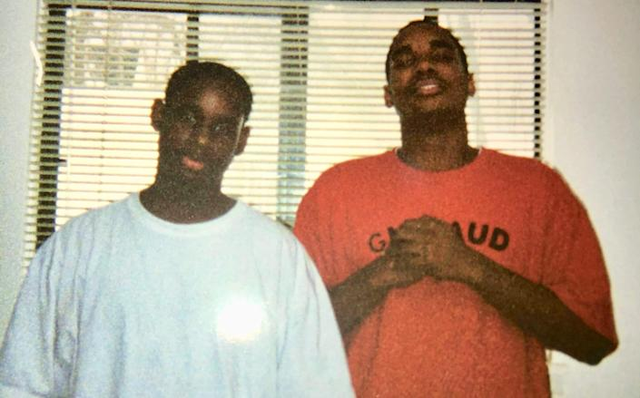 McKenzie Cochran of Ferndale, left, poses in this undated photo with his brother, Michael Cochran, who hopes the Black Lives Matter movement helps reopen his brother's death investigation.