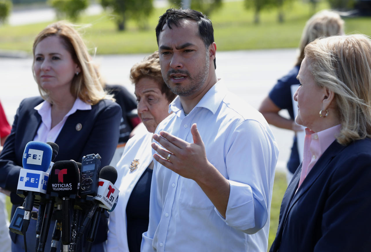 Rep. Joaquin Castro, D-Texas, second from right, chairman of the Congressional Hispanic Caucus, speaks during a news conference after touring the Homestead Temporary Shelter for Unaccompanied Children with Rep. Debbie Mucarsel-Powell, D-Fla., left, Rep. Donna Shalala, D-Fla., second from left, and Rep. Sylvia Garcia, D-Texas, right, Tuesday, Feb. 19, 2019, in Homestead, Fla. (AP Photo/Wilfredo Lee)