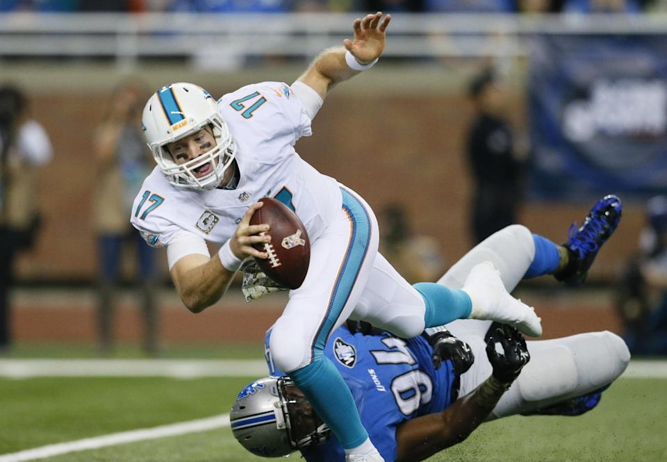 Miami Dolphins quarterback Ryan Tannehill (17) is sacked by Detroit Lions defensive end Ezekiel Ansah (94) during the first half of an NFL football game in Detroit, Sunday, Nov. 9, 2014. (AP Photo/Rick Osentoski)