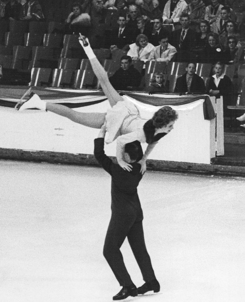 Dudley Richards lifts Maribel Y. Owen in a winning effort in the Senior Pairs competition at the National Figure Skating Championships in Colorado Springs, on Jan. 28, 1961.