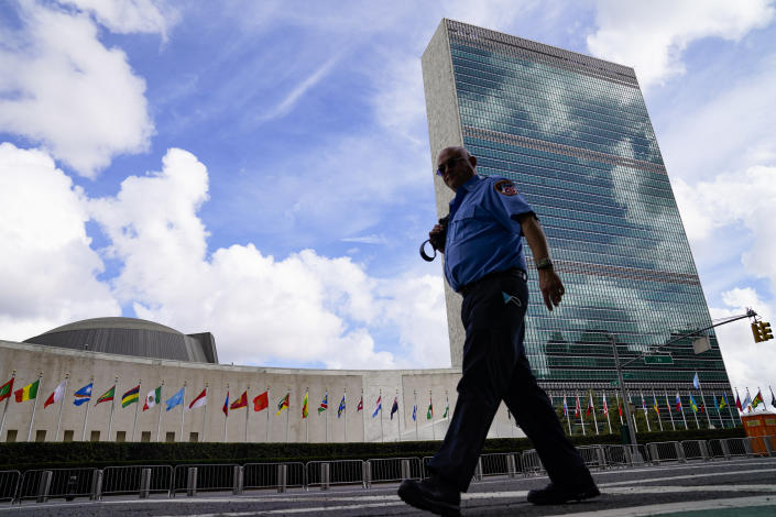 A member of the FDNY passes outside the United Nations headquarters, Tuesday, Sept. 21, 2021, during the 76th Session of the U.N. General Assembly in New York. (AP Photo/John Minchillo, Pool)