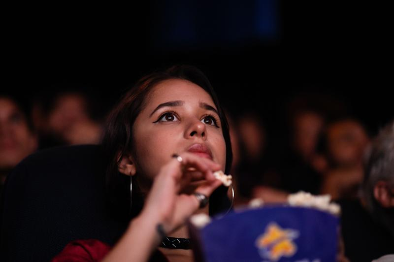 "Venezuelan filmgoers watch the first screening in Venezuela of Marvel Studios' ""Avengers: Endgame"" at a cinema in Caracas on early April 26, 2019. - The ""Avengers: Endgame"" movie was screened early morning in Caracas to work around blackout and safety issues. (Photo by Federico PARRA / AFP) (Photo credit should read FEDERICO PARRA/AFP/Getty Images)"
