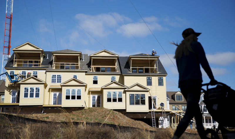 <p> FILE - In this Wednesday, Feb. 17, 2016, file photo, town homes stand under construction as a pedestrian walks along the BeltLine in Atlanta. The Commerce Department releases its latest data on new residential home construction, Thursday, Jan. 18, 2018. (AP Photo/David Goldman, File) </p>
