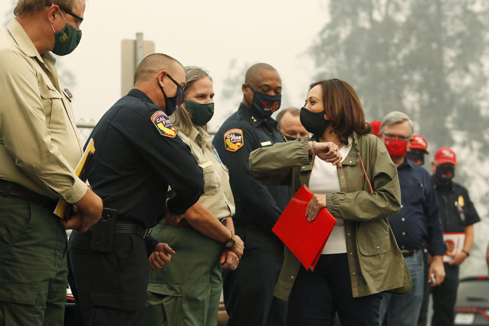 Democratic vice presidential candidate Sen. Kamala Harris, D-Calif., bumps elbows with first responders as she was briefed on the Creek Fire at Pine Ridge Elementary, Tuesday, Sept. 15, 2020 in Auberry, Calif. (AP Photo/Gary Kazanjian)