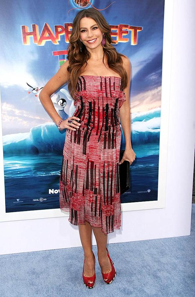 "Another brunette beauty was also dressed to impress this week. ""Modern Family"" minx Sofia Vergara wore this colorful Carolina Herrera dress to the premiere of ""Happy Feet Two."" We're guessing her feet were also happy to be rocking such cute platform slingbacks. (11/13/2011)"
